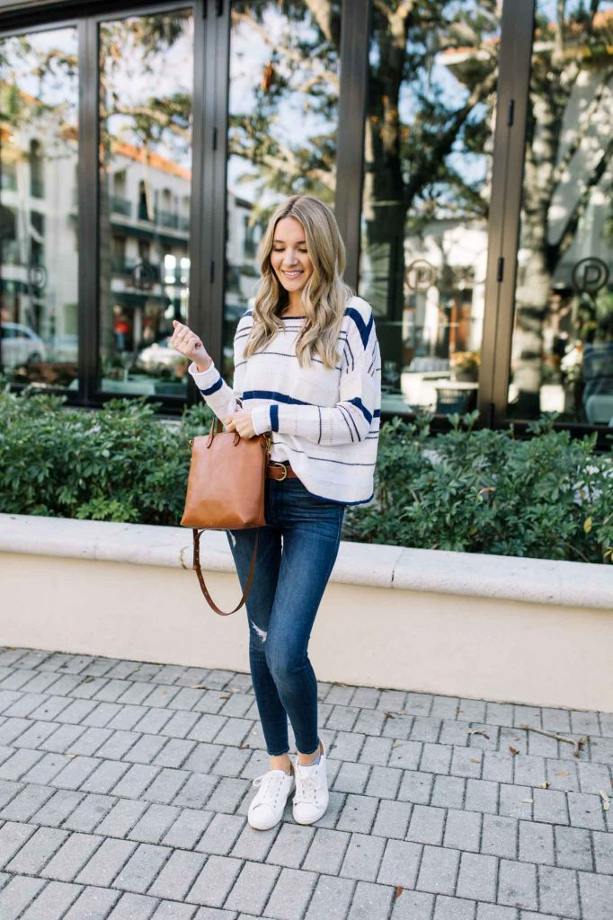 stripe sweater with brown tote