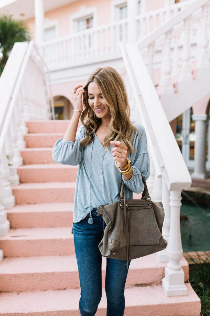 pastel top with grey bag