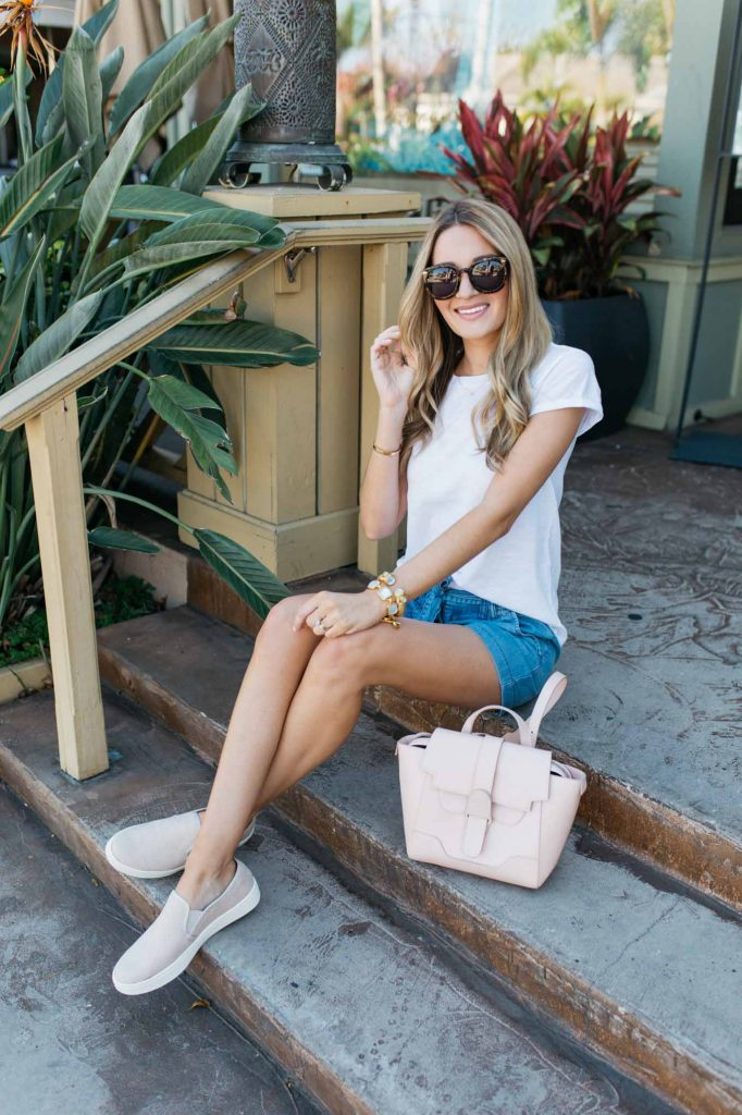 Blue Top with Denim shorts and pink bag