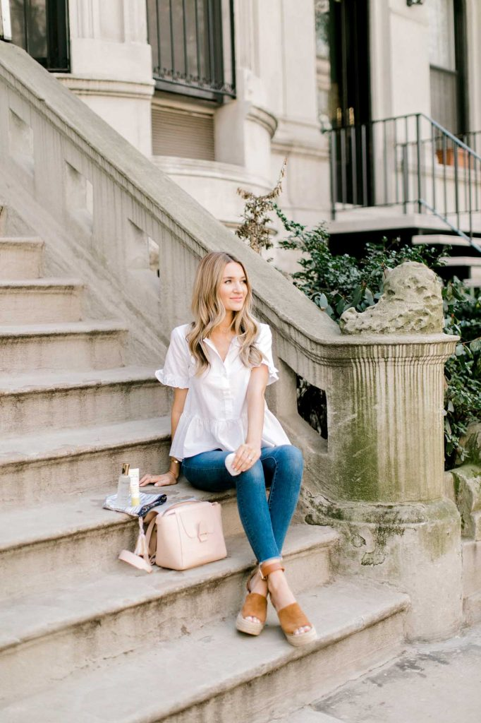 white ruffle top with jeans
