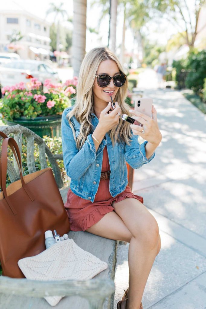 Denim Jacket with Linen Romper and brown tote