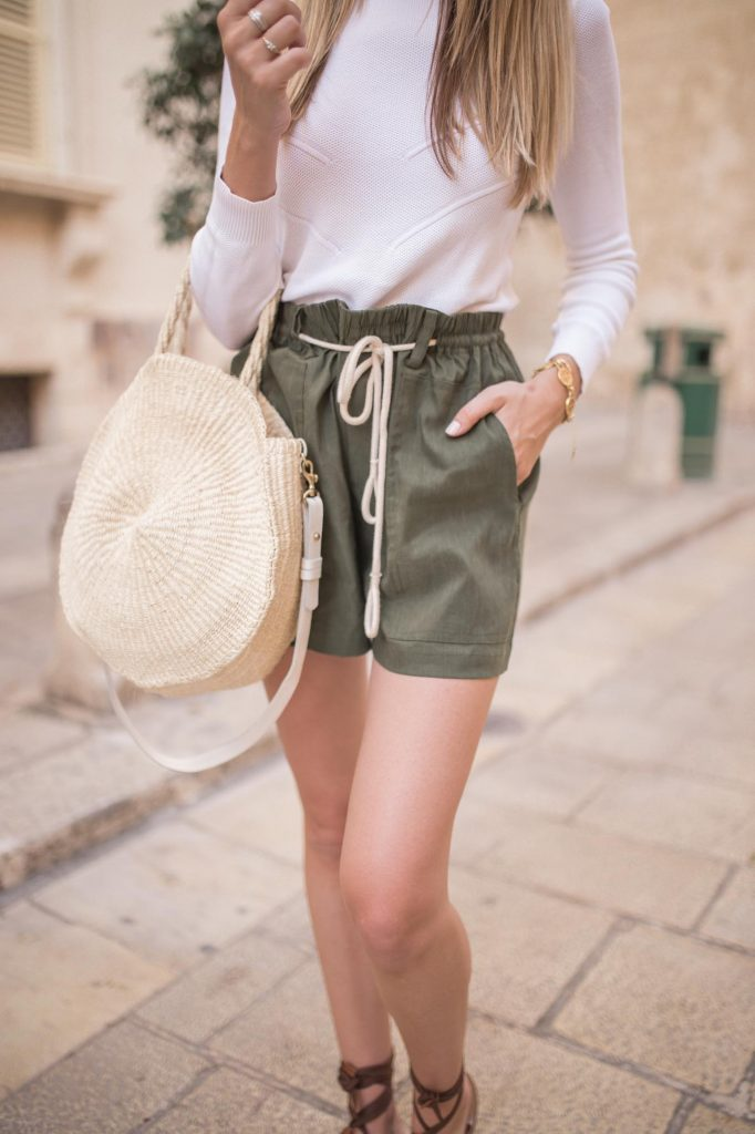 Olive green shorts with tie and straw bag