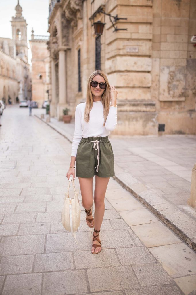 White top with green shorts outfit