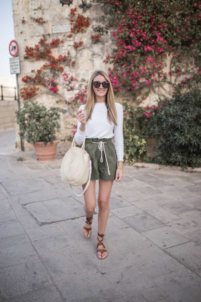 Sweater with shorts and sandals