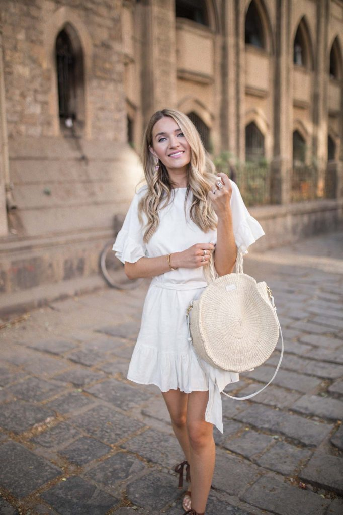 round straw tote with linen dress
