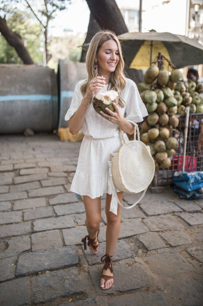 white linen dress with straw tote