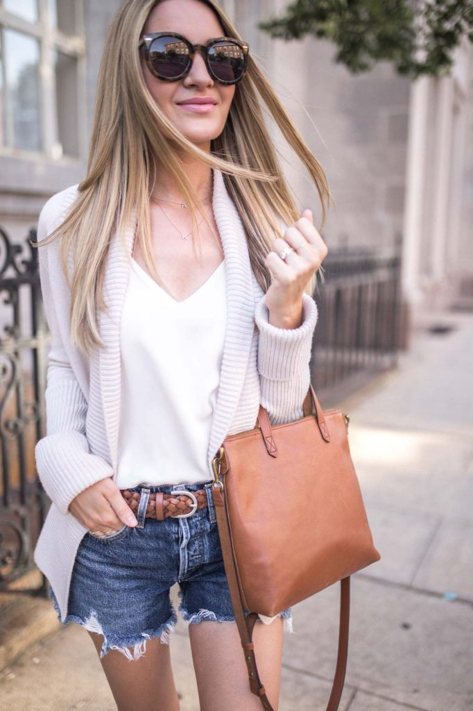 Neutral cardigan and brown tote