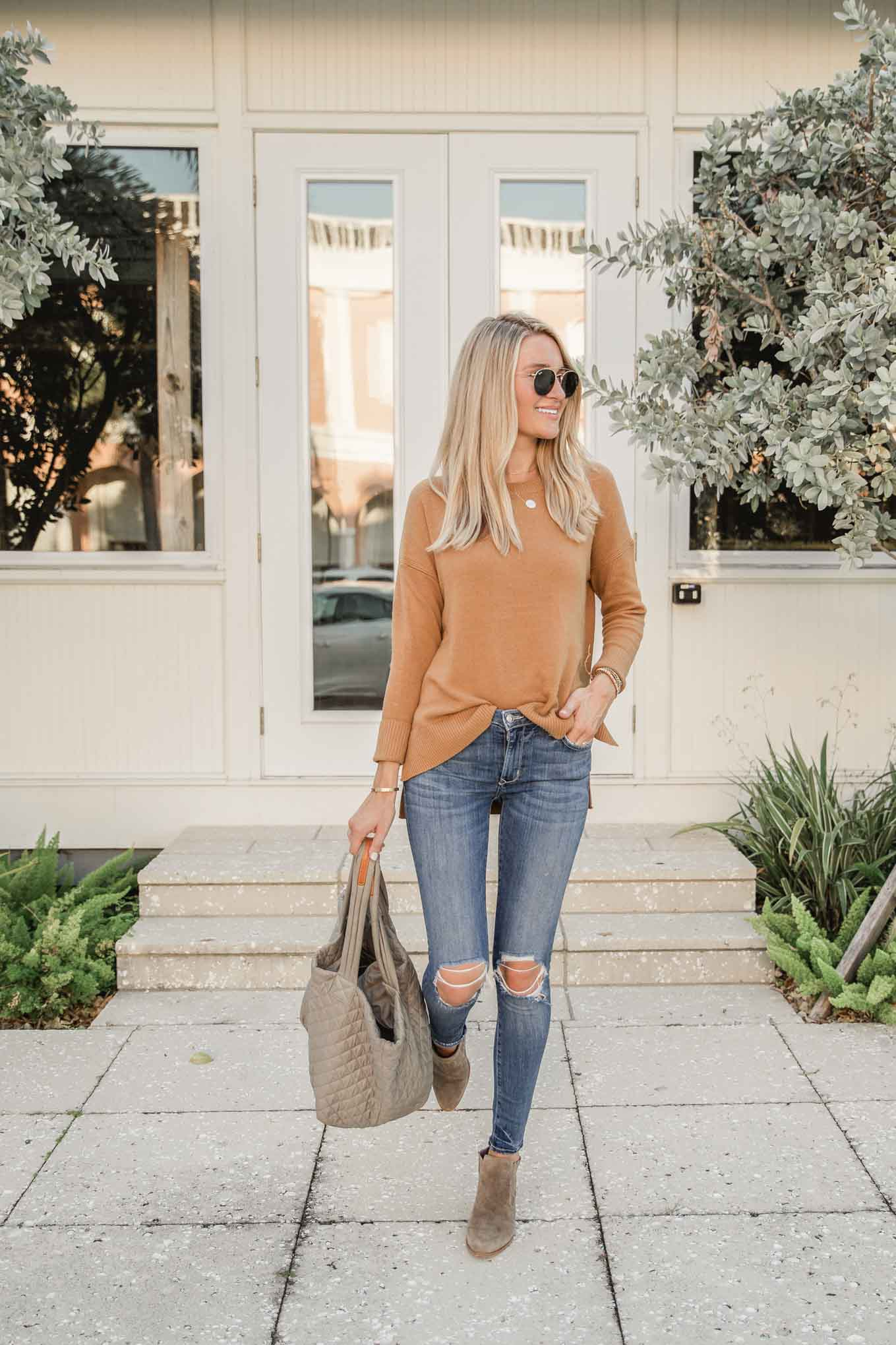 Tan sweater and distressed denim